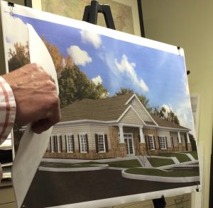 Victor Kelly, an engineer, display a rendering of the proposed daycare facility at the Riverside at Chadds Ford community.