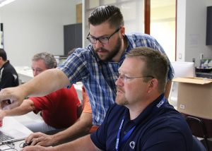Technical College High School teachers participate in a training session led by Siemens to learn how to use the Solid Edge software.
