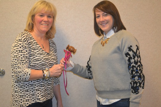 Outgoing Unionville Community Fair President Danielle Chamberlain (left) passes the gavel to her successor, Deb Deckman.