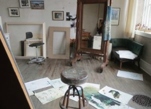 A somewhat unkempt studio contrasts with the precision that Andrew Wyeth achieved in his paintings.