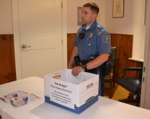 New Garden Township Police Officer Matthew Jones offers a safe way to dispose of unwanted medication.