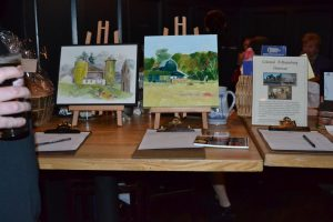 This year's Guest Bartending Fundraiser includes a host of coveted silent auction items ranging from paintings to restaurant gift certificates.