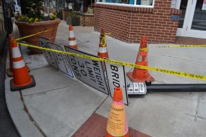 A series of signs and a pedestrian crossing pole were among the casualties of a truck that didn't make the corner.