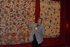 Linda Eaton, Winterthur's project curator, shows off some of the elegant textiles in 'Made in the Americas.'