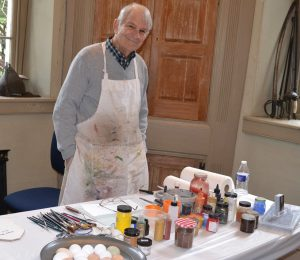 Artist Terry Wolf says he enjoys sharing the magic of mixing tempera paints.