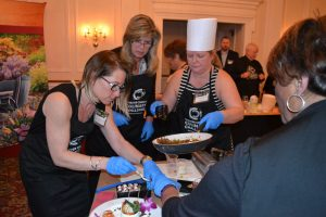 All hands are busy as the clock approaches the deadline for completing the Chester County Culinary Challenge.