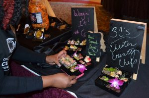 Completed Bento boxes are displayed to an admiring audience.