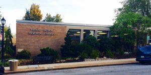 The Kennett Public Library facade displays the facility's former name: The Bayard Taylor Memorial Library.