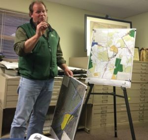 Jack Stefferud from Natural Lands Trust uses maps to explain an effort to protect land at Castle Rock Farm, 16 acres of which lie within Pocopson Township.