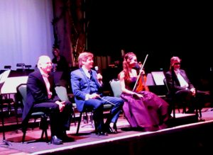 Artists converse with the audience after the concert. From left to right: Concertmaster Eliezer Gutman, Conductor Michael Hall, Soloist Margaret Dziekonski, and Principal Oboe Terence Belzer