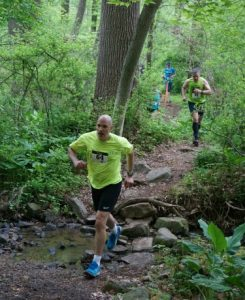 Runners during the 215 race enjoy a stream crossing and beautiful views during the 'Race for Conservation.'