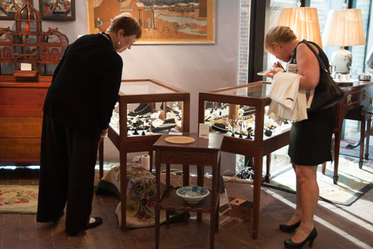 Shoppers check out some jewelry on display during the opening night of the 45th annual Antiques Show at the Brandywine River Museum of Art.