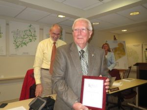 Bob Perrone receives a plaque for this 37 years of township service. He stepped down last month from the Kennett Township Zoning Hearing Board.
