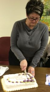 Pocopson Township Supervisor Alice Balsama cuts her birthday cake after the meeting.