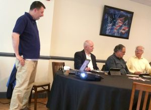 John Hendrix (left), who heads children's services at the Kennett Library, gives an overview of the summer programs. To his right are board members Stan Allen, Jeff Yetter and Tom Swett.
