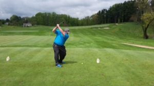 A golfer swings at the first hole at the Golf Course at Glen Mills.