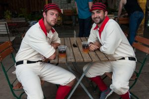 "Cap 1: Matt Ticknor, left, and Michael Kelly, of the Kennett Square Mohicans are in their old style uniforms in honor of Theodore Pennock, one of the brothers who founded the original creamery in 1902 and who played with the original Kennett Square Mohicans. The current team plays ""1864"" style baseball with the old rules where pitching is underhand and a batter is out if an infielder catchers a groundball on one bounce."