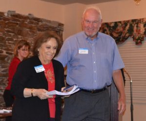 Pocopson Township Supervisors' Chairwoman Ricki Stump (left) and Jeff Taylor, a Pocopson resident, receive copies of the latest publications detailing the Battle of the Brandywine.