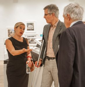 Sophie Blackhall makes a point while talking with museum Director Tom Padon, center, and guest curator Nick Clark.