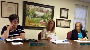 Pocopson Township Supervisors Ricki Stumpo (from right) and Elaine DiMonte listen as Alice J. Balsama discusses the Barnard House.