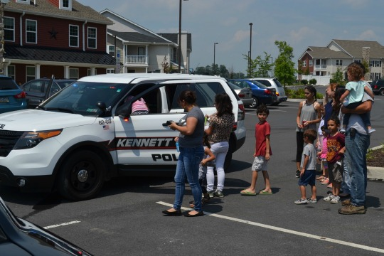 Children in the Granite Ridge complex in Kennett Township wait to climb inside a police vehicle. The event was a run-up to the Kennett Square Sixth Annual National Night Out on Tuesday, Aug. 2.