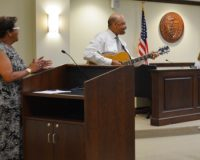 Sandra Murphy, (from left) Chester County's Department of Aging director, accompanies Commissioners' Chairman Terence Farrell in a rendition of 'You Are My Sunshine' as Commissioner Michelle Kichline enjoys the performance.
