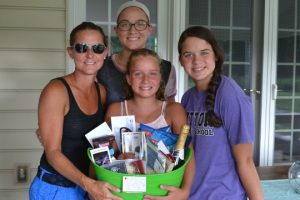 The Harlan women (clockwise from left), Tricia, Paige, Kylie and Delaney, show off their balloon-landing treasures.