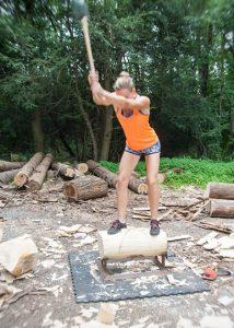Martha King's axe blade is a blur as she powers through a swing.