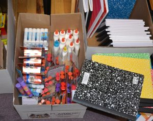 An assortment of notebooks, paper, and writing implements will be distributed to young crime victims.