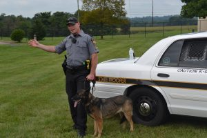 Trooper Jason Landermilch gives a K-9 demonstration during Sunny Day Camp on Saturday, Aug. 6.