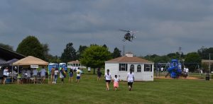 Eyes are on the sky as Cpl. Michael P. Becker does a fly-over at Sunny Day Camp.