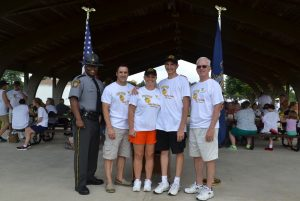 Capt. Maurice A. Tomlinson (from left) poses with Maj. William P. White, director of the state police Bureau of Training and Education; Trooper Samantha Minnucci; her brother Gabriel Minnucci; and Greg Cary, a retired police officer and Camp Cadet board member.
