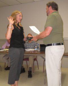 Kennett Square Mayor Matt Fetick (right) swears in Stephanie Everett as an alternate on the borough's Civil Service Commission.