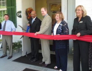 Scott Miller of Miller Designworks, Chester County Commissioners' Chairman Terence Farrell, state Rep. Duane Milne, and CCCVB's Jan Reeps and Susan Hamly participate in the ribbon-cutting.