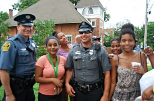 Police officers and kids mingle during the Sixth Annual National Night Out in Kennett Square.