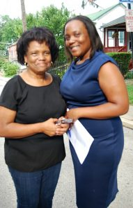 Theresa Bass (left), president of the Carter CDC, poses with her daughter, LaToya Myers,