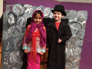 2015-2016 Preschool students Aarika Patel, left, of Glen Mills, and August Raines, right, of West Chester, participate in a drama activity with costumes and set pieces.