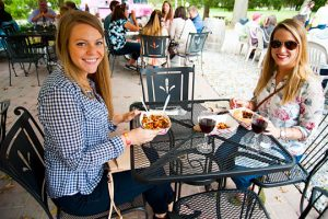Monique Hedwall and Kelly Keating, both from West Chester, enjoy some food and wine at the Chaddsford Winery.