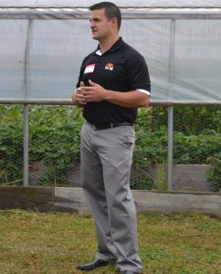 Joel Smith, a systems account executive with Tri-M, explains his company's involvement with the Patton Project Gardens.