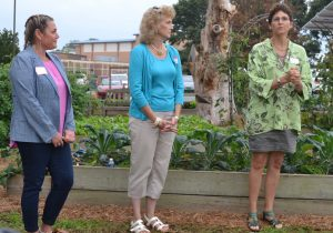 Patton Project Gardens' creators Kim Hisler and Betsy Ballard, listen as the Chester County Food Bank's Phoebe Kitson-Davis applauds its impact.