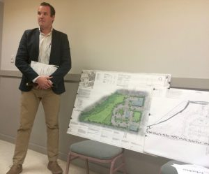 Mike Pia Jr. displays the engineering changes in the plans for Cannery Row, a mixed-use development on South Mill Road.