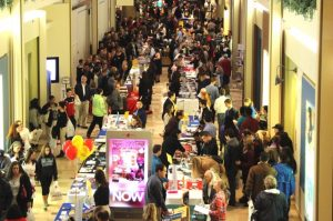 Students and families meet with college representatives during the 2015 fair.