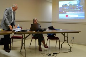 Greg Lukmire (left) and Toni Garvey confer prior to a wrap-up on the sessions aimed at soliciting feedback about a new library center.