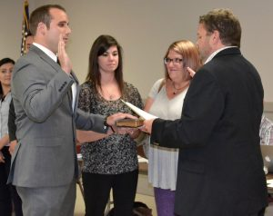 Kevin Thompson (left) is sworn in as a part-time police officer by Kennett Square Mayor Matt Fetick (right).