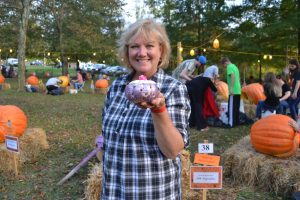 """Veteran carver April Margera, proprietor of the Rose Hip Barn, displays a cupcake made from a pumpkin to accent her """"Tea Time at Rose Hip"""" theme."""