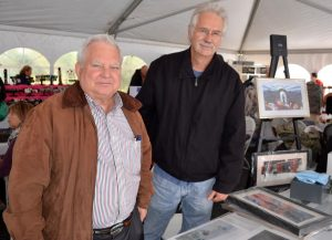 Artist Karl J. Kuerner III (left) is joined by Nick Cerchio, his representative, in the Artisan's Gallery.