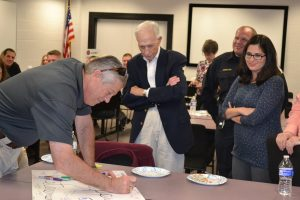 Colleagues sign a farewell poster for Tom Glass at this retirement part last week.