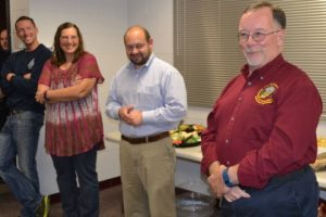 As his son Matthew (from left), wife Lisa, and Robert Kagel, director of Chester County's Department of Emergency Services, listen, Tom Glass thanks the audience for his satisfying, 42-year career.