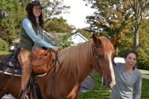 Ashley Lepere of Westtown Township enjoys meeting Spike, the horse transporting Mindy Rhodes Worth through Westtown Township.