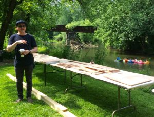 Dylan Gauthier, the Brandywine Conservancy & Museum of Art's artist-in-residence gives volunteers a quick primer on boat-building.
